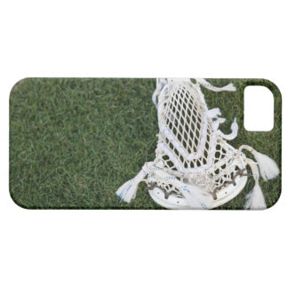 Lacrosse stick on grass iPhone 5 covers