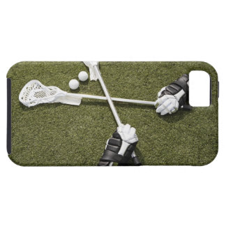 Lacrosse sticks, gloves and balls on artificial case for the iPhone 5