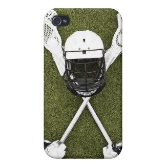 Lacrosse sticks, gloves, balls and sports helmet iPhone 4 case