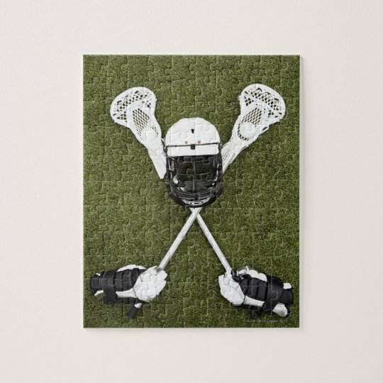 Lacrosse sticks, gloves, balls and sports helmet jigsaw