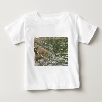 Ladder descending into the sea water tee shirt