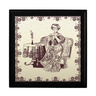 lady drinks tea large square gift box