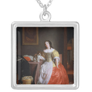 Lady in a yellow and red dress silver plated necklace