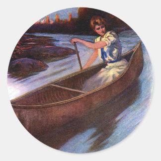 Lady Paddling Canoe Down Waterway Classic Round Sticker