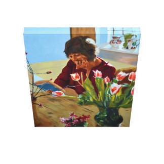 Lady reading alone at the kitchen table canvas print