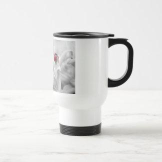 Ladybug in red travel mug