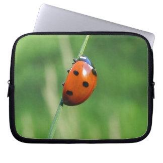 Ladybug on a blade of grass laptop computer sleeve