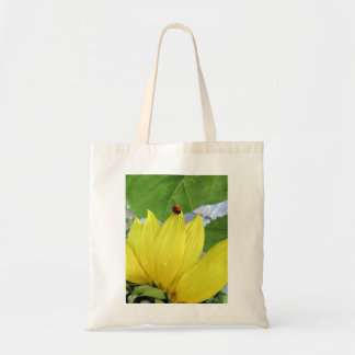 ladybug on a sunflower tote bag