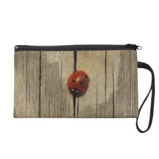 Ladybug on wood wristlet clutch