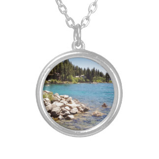 Lake Tahoe's clear waters with snowy mountains Round Pendant Necklace