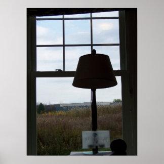 lamp against landscape print