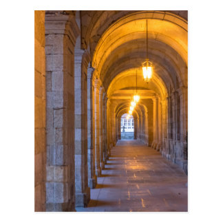 Lamp lit stone hallway, spain postcard