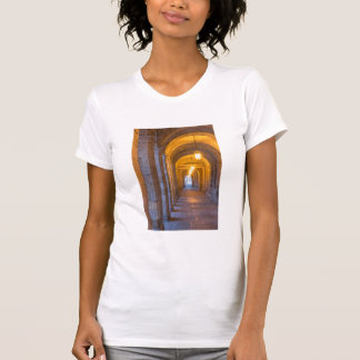 Lamp lit stone hallway, spain T-Shirt
