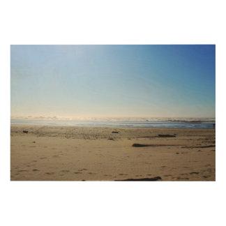 Landscape photography of sea, sand beach, blue sky wood print