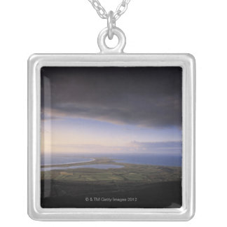 landscape with an overcast sky silver plated necklace