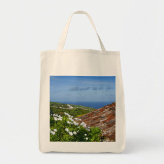 Landscape with daisies grocery tote bag
