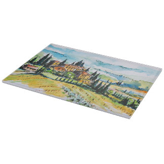 Landscape with town and cypress trees cutting board