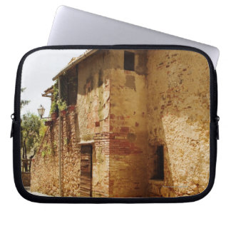 Lantern mounted on the wall of a building, laptop sleeve