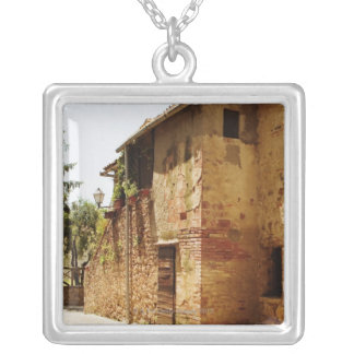 Lantern mounted on the wall of a building, silver plated necklace