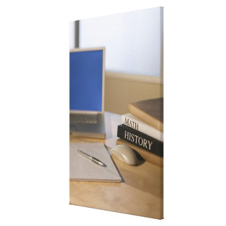 Laptop computer and textbooks canvas print