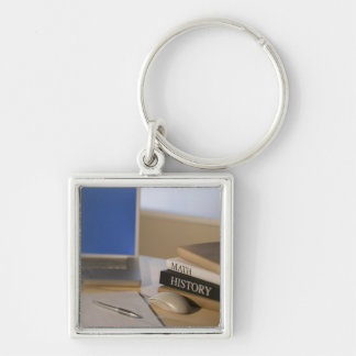 Laptop computer and textbooks key ring