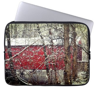 Laptop sleeve with snowy red covered bridge
