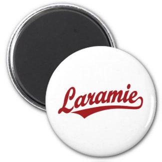 Laramie script logo in red 6 cm round magnet