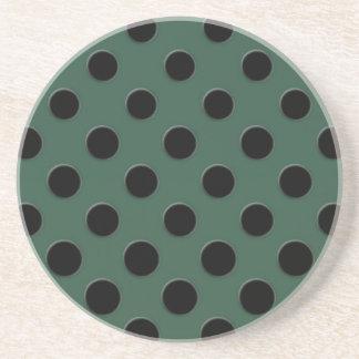 Large black polka dots on dark green beverage coasters