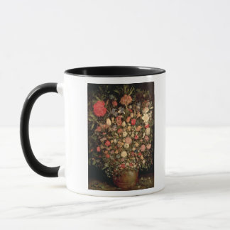 Large bouquet of flowers in a wooden tub mug
