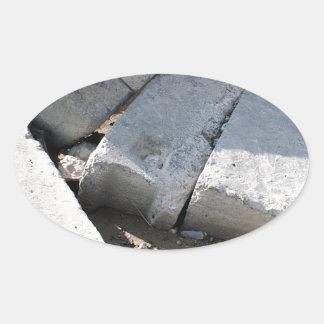 Large concrete building blocks closeup oval sticker