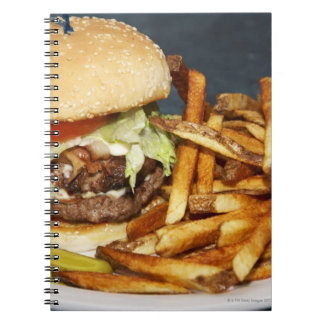 large double half pound burger fries and cola notebooks
