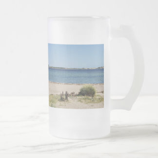 Large glass cup beach and sea
