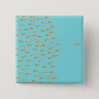 Large group of goldfish facing one lone goldfish 15 cm square badge