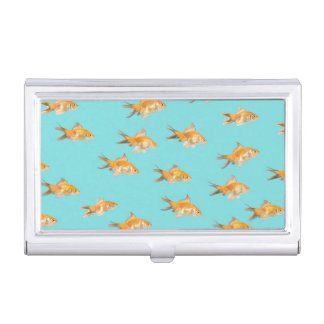 Large group of goldfish facing one lone goldfish business card holder