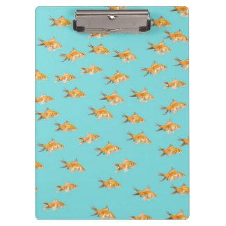 Large group of goldfish facing one lone goldfish clipboard