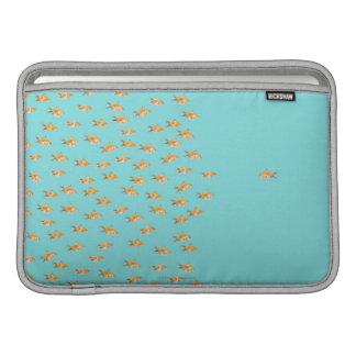 Large group of goldfish facing one lone goldfish MacBook sleeve