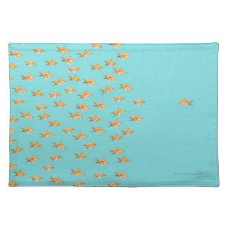 Large group of goldfish facing one lone goldfish placemat