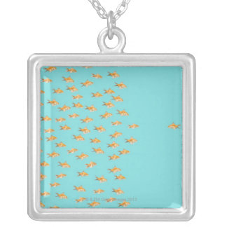Large group of goldfish facing one lone goldfish silver plated necklace