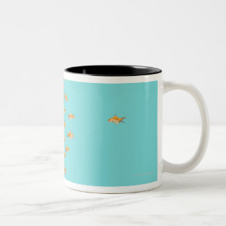 Large group of goldfish facing one lone goldfish Two-Tone coffee mug