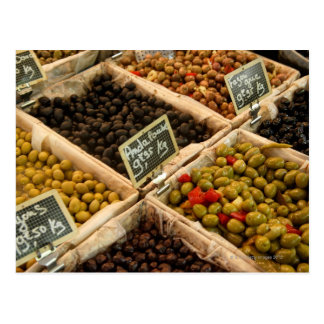 Large open boxes of black and green olives for postcard