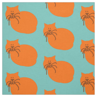 Large Orange cat with whiskers on colored fabric