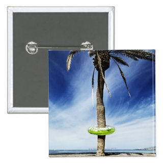 Large palm tree on a sandy beach with inflatable 15 cm square badge