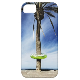 Large palm tree on a sandy beach with inflatable iPhone 5 case
