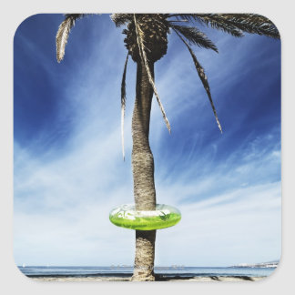Large palm tree on a sandy beach with inflatable square sticker