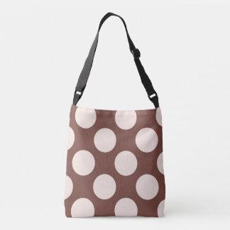 Large pink polka dots design on brown crossbody bag