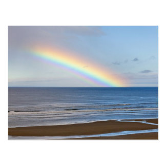 Large rainbow over the Pacific Ocean at Postcard