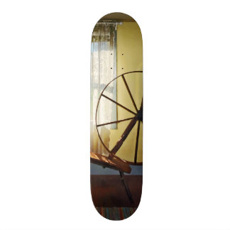 Large Spinning Wheel Near Lace Curtain Skate Deck