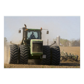 Large tractor cultivating spring soil on a poster