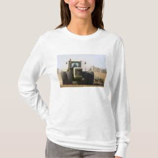 Large tractor cultivating spring soil on a T-Shirt