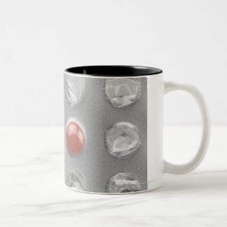 Last pill in blister pack, photographed on white Two-Tone coffee mug
